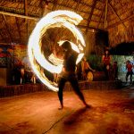 A fire dancer spins
